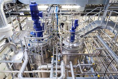 Legend: The building block for Clariant's new bio-based cosmetics polymer is produced in Global Bioenergies' demonstration plant in Leuna, Germany.