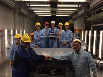 Henkel team with first treated car body after the brownfield conversion. (Photo: Henkel, PR037)