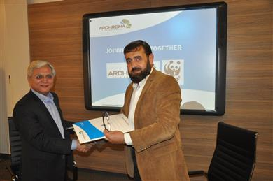 Mujtaba Rahim (left), CEO, Archroma Pakistan Limited, and Zahid Sultan Jadoon, Director Operations, WWF Pakistan, exchanging documents of the Memorandum of Understanding signed between the two organizations at a ceremony held in Karachi. 