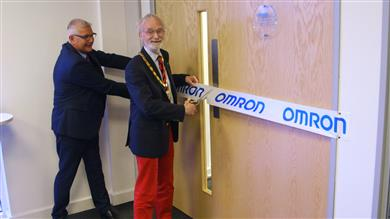 The Mayor of Milton Keynes, Councillor Martin Petchey, officially opening the Omron Robotic Innovation Lab on Wednesday with Mark Butters, UK General Manager, Omron. 