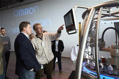 Omron's AI controller is the first controller on the market to feature built-in artificial intelligence. This product enables process adjustments in real time on the factory floor without using the cloud. A demonstration involving the controller attracted plenty of attention at the Omron AI conference. (Photo: Omron, PR071)