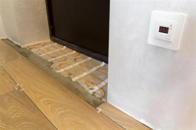 Example of under floor heating pipe systems made possible by SABIC® SUPEER™ P8200RT.