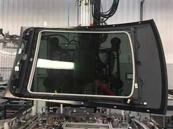 The sunroof module arrives at Renault's assembly plant fully assembled and pretested as a one-piece ready to install unit which is robotically bonded to the vehicle roof, cutting out two-to-three assembly steps, thereby increasing productivity. (Photo Polyscope, PSPR019)
