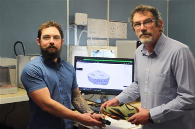 L-R: Martin Campbell and Ewan Conaghan, NZDF engineers adjusting the PLA 3D printed prototype to ensure good form and fit. 